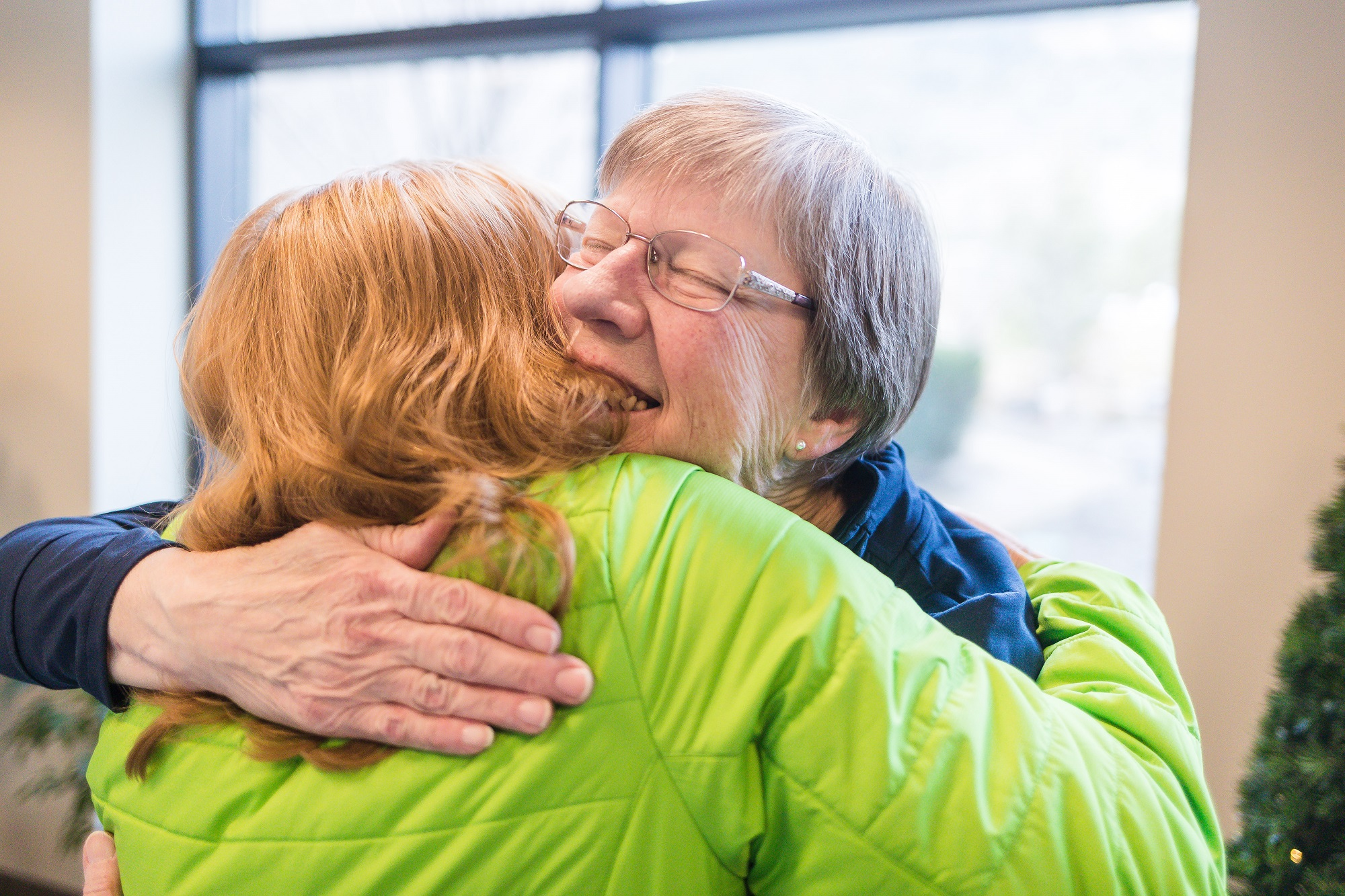 Image of Lynette getting a hug at the branch