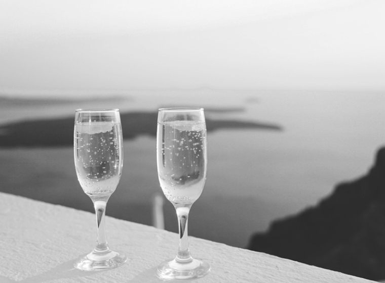 Two glasses of sparkling wine overlooking an ocean view
