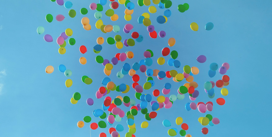 Image of balloons floating into the air