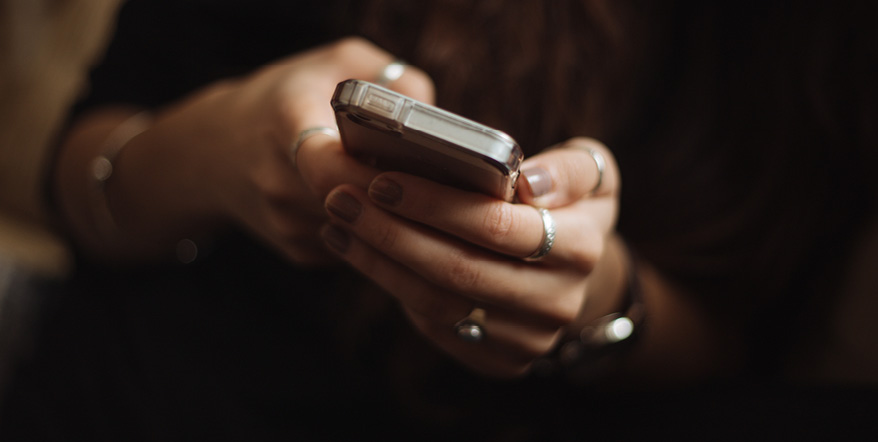 Image of woman's hands holding smartphone.