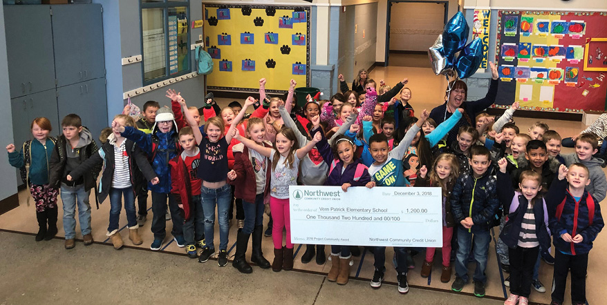 Students at Vern Patrick Elementary with their teacher and a giant Project Community award check