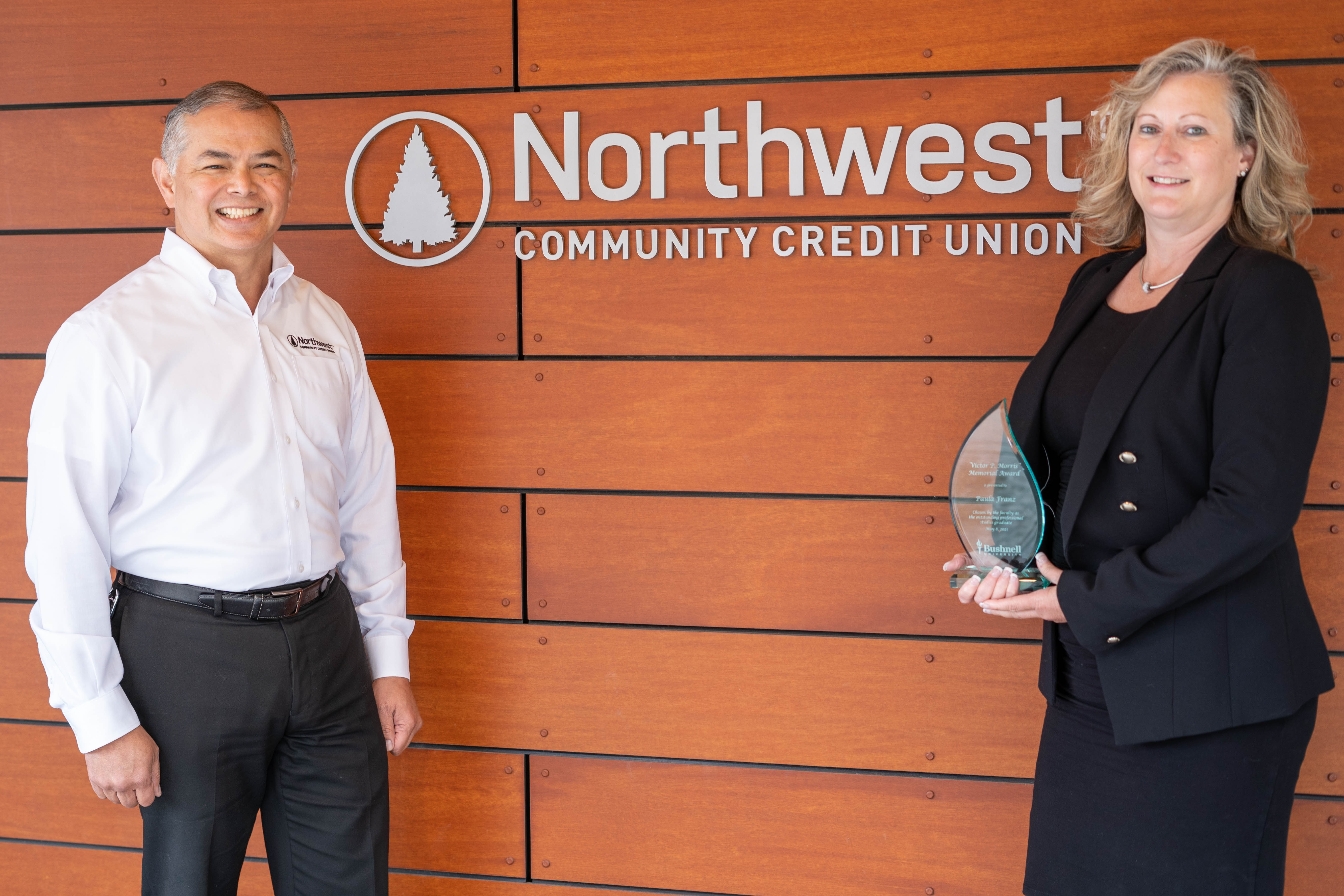 NWCU's CEO John Iglesias with Paula Franz, recipient of the V.P. Morris Award for Outstanding Professional Studies